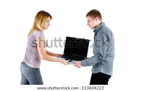 young couple takes away from each other laptop. isolated white background - stock photo