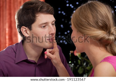 Young couple  talking and flirting at first date in restaurant - stock photo