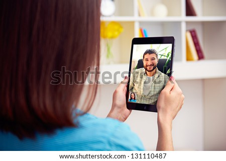 young couple talking online video chat - stock photo