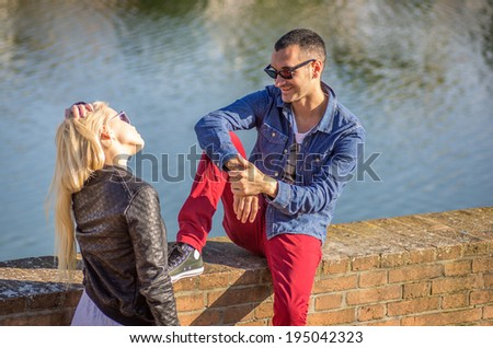 Young couple talking while on a date - stock photo