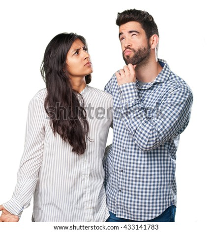 young couple thinking about something - stock photo