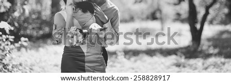 Young couple together in park spending time. - stock photo