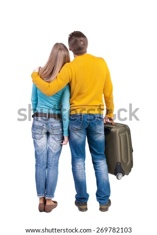 young couple traveling with suitcas. Back view. Rear view people collection.  backside view of person.  Isolated over white background. - stock photo