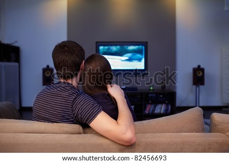 Young couple waching  movie on tv - stock photo