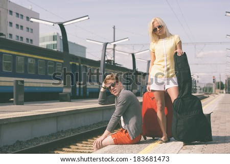 Young Couple Waiting at Train Station - stock photo