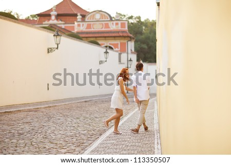 Young couple walking in old town of Prague - stock photo
