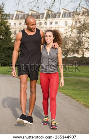 young couple walking together after exercise - stock photo