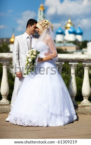 Young couple wedding. Standing at the railing. - stock photo