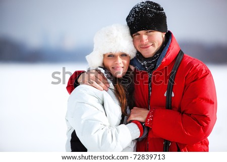 Young couple winter outdoors portrait. - stock photo