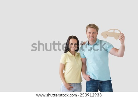 Young couple with a cardboard car - stock photo