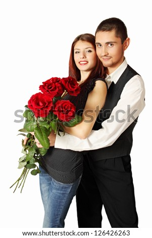 Young couple with bouquet a rose on a white background - stock photo