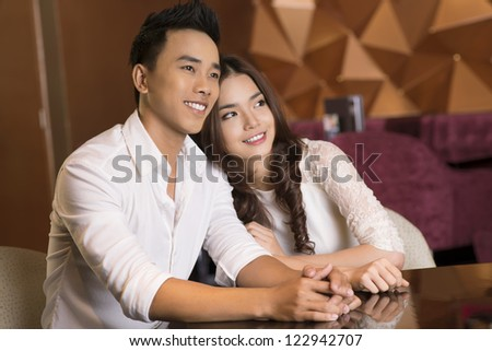Young couple with candid smiles enjoying a moment together - stock photo