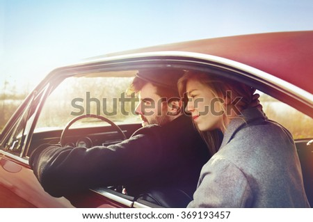 Young couple with car - stock photo