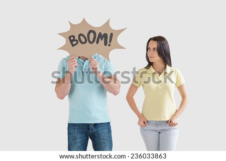 Young couple with cardboard objects - stock photo