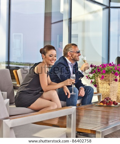Young couple with champagne glasses in restaurant - stock photo