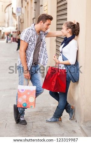 Young Couple with Shopping Bags - stock photo
