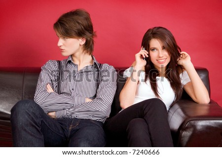 Young couple ( woman make man jealous ) - stock photo