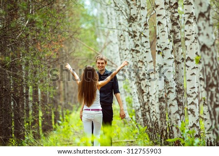 Young couples dating at summer birch forest background. - stock photo
