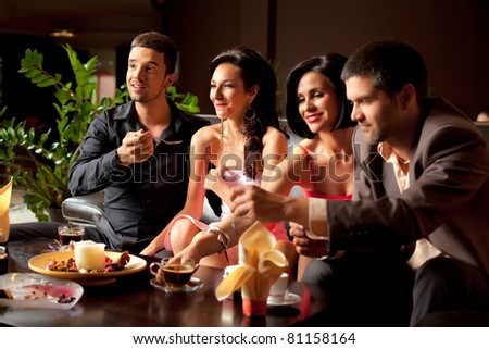 young couples having fun over dessert and coffee - stock photo