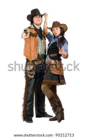 Young cowboy and cowgirl with a guns in hands - stock photo