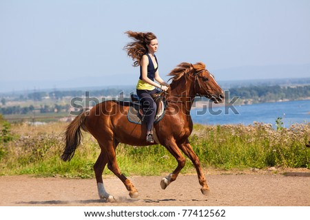 young cowgirl on brown horse - stock photo