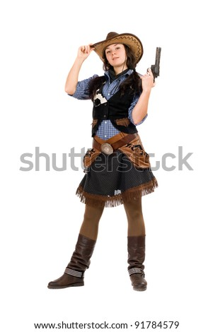 Young cowgirl with a gun in hands. Isolated on white - stock photo