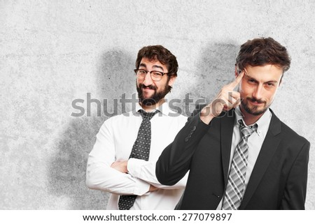 young crazy businessman intelligence gesture - stock photo