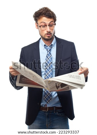 young crazy businessman surprised with a newspaper - stock photo