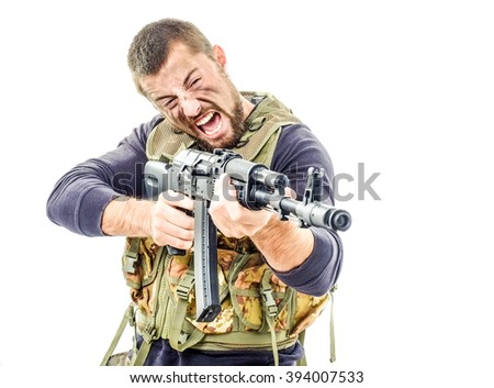Young crazy soldier shooting a rifle isolated on white background - stock photo
