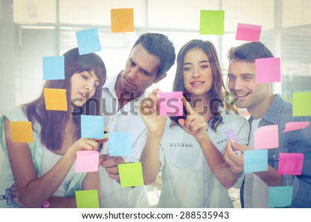 Young creative business people looking at the photo editor at office - stock photo