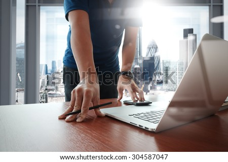 Young creative designer man working at office with computer laptop as concept       - stock photo