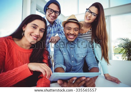Young creative team having a meeting in casual office - stock photo