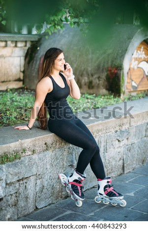 Young curvy woman texting on the street - stock photo