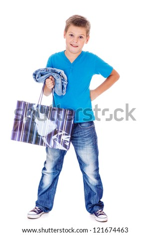 Young customer holding paper bag and jeans in hands - stock photo