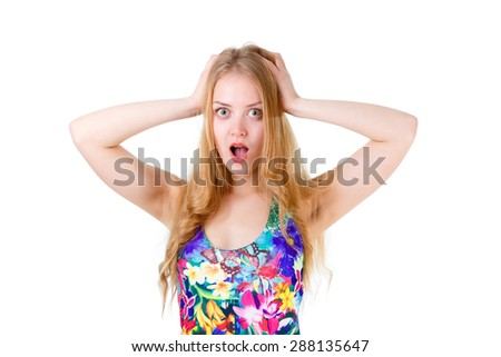 Young cute girl teenager surprised with hands on her head isolated on white background, human emotion, facial expression - stock photo