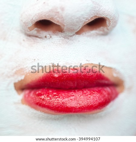 Young cute girl with a self made beauty mask - stock photo