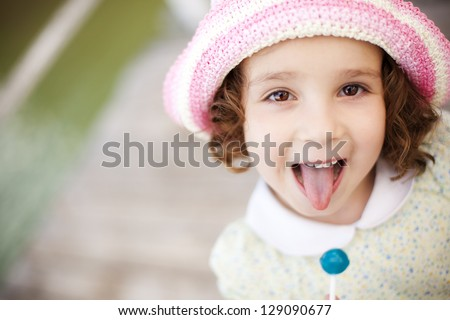 Young cute little girl gesturing with her mouth - stock photo