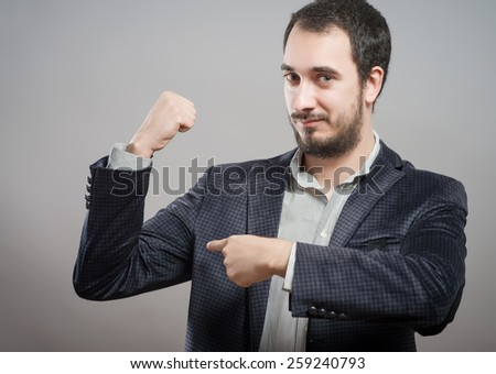 Young cute man shows the biceps - stock photo