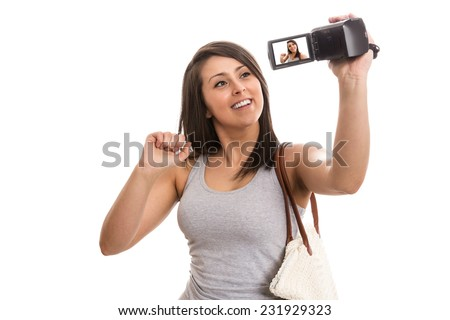 Young cute tourist recording video greetings - stock photo