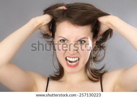 Young cute woman in angry mood - stock photo