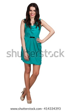 Young cute woman in green posing on white background - stock photo