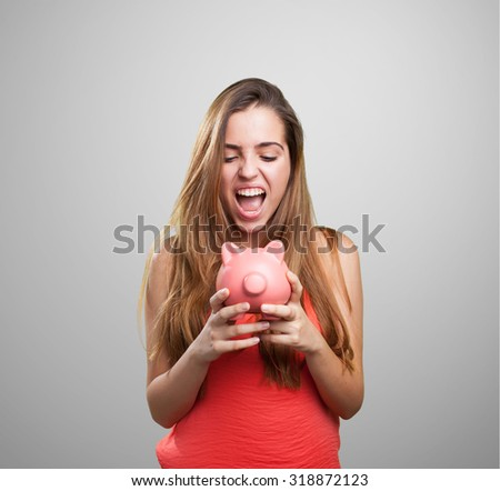 young cute woman shouting to her piggy bank - stock photo