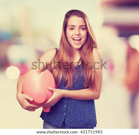young cute woman with a big piggy bank - stock photo