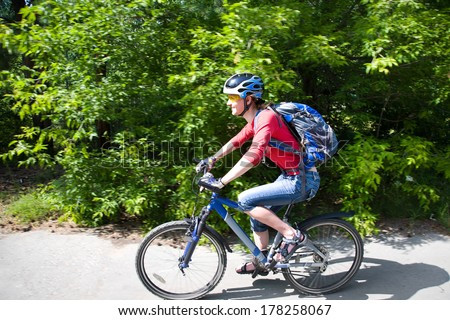 young cyclist rides from green  park - stock photo