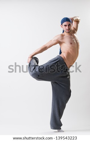 Young dancer in action, studio shot - stock photo