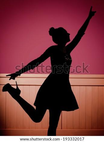 Young dancing woman - stock photo