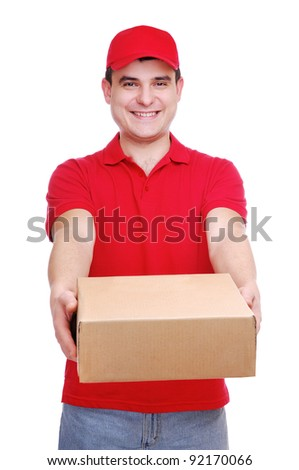 Young delivery man in red uniform holding the parcel box on white background - stock photo