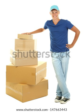 Young delivery man with parcels, isolated on white - stock photo