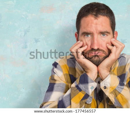 young depressed man - stock photo