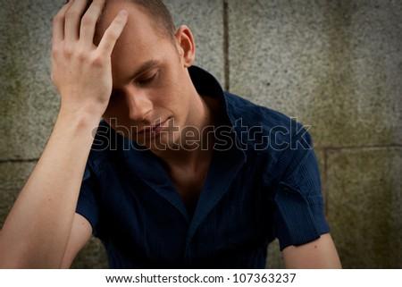 Young depressed sad man - stock photo
